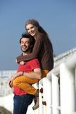 Young couple smiling and having fun outdoors Royalty Free Stock Photos