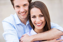 Young couple smiling. And hugging Royalty Free Stock Photography