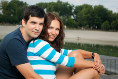 Young couple smiling and hugging in park Royalty Free Stock Photo