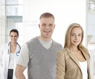 Young couple smiling at medical center Royalty Free Stock Image