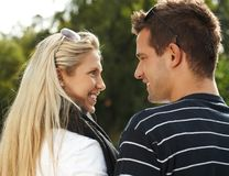 Young couple smiling outdoors Royalty Free Stock Photo