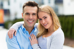 Young couple smiling outdoors Stock Images