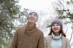 Young couple smiling in park in winter Stock Photo