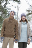 Young couple smiling in park in winter Stock Photos