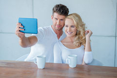 Young couple smiling for a selfie Stock Photo