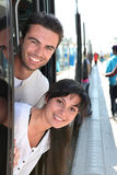 Young couple smiling in tramway. Couple smiling standing in tramway Stock Photo