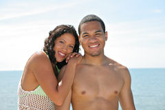 Young Couple Smiling by Water Front Royalty Free Stock Photography