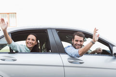 Young couple smiling and waving Stock Photography