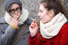 Young couple smoking Stock Photography
