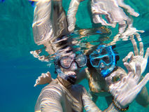 Young couple snorkeling in the honeymoon Stock Image