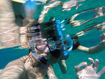 Young couple snorkeling in the honeymoon. Romantic couple snorkeling in the sea Stock Image