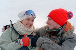 Young couple on snow Royalty Free Stock Images
