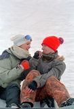 Young couple on snow Stock Photos