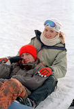 Young couple on snow Royalty Free Stock Photos
