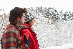 Young couple in snow Royalty Free Stock Photo