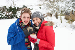 Young couple in snow Royalty Free Stock Image