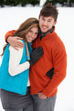 Young couple in snow Stock Photography