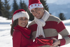 Young couple on the snow Stock Photo
