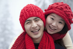 Young Couple in the Snow Royalty Free Stock Images