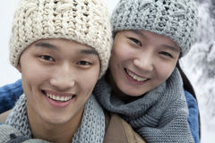 Young Couple in the Snow, Looking At Camera Royalty Free Stock Photos