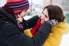 Young couple on snow Royalty Free Stock Image
