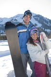 Young couple of snowboarders Royalty Free Stock Photos