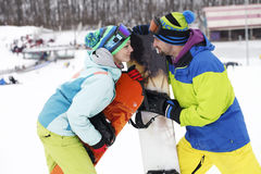 Young couple snowboarders rejoice and be glad Stock Photos