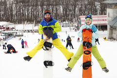 Young couple snowboarders rejoice and be glad Royalty Free Stock Image