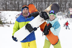 Young couple snowboarders rejoice and be glad Stock Image