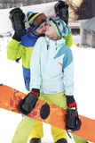 Young couple snowboarders rejoice and be glad Royalty Free Stock Photo