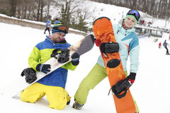 Young couple snowboarders rejoice and be glad royalty free stock photos