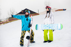 Young couple of snowboarders Stock Photo