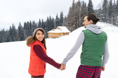 Young Couple Snowy Village Wooden Country House Man And Woman Winter Snow Resort Cottage Royalty Free Stock Photos