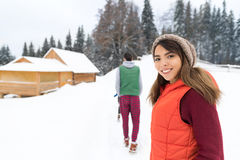Young Couple Snowy Village Wooden Country House Man And Woman Winter Snow Resort Cottage Stock Photos