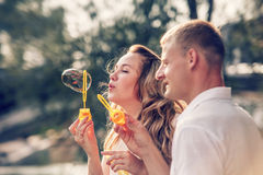 Young couple soap bubbles Royalty Free Stock Image