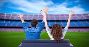 Young couple of soccer fans supporting their team or celebrating Royalty Free Stock Image