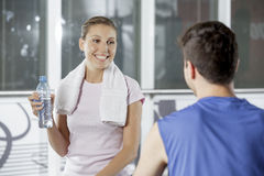 Young couple socializing at the gym Stock Photography