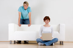 Young couple and sofa Stock Image