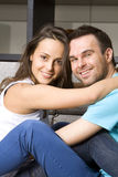 Young couple on a sofa Royalty Free Stock Image