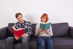 A young couple on a sofa Stock Photography