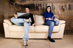 Young couple on sofa Royalty Free Stock Photo