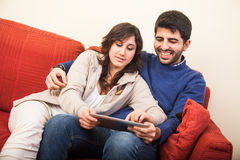 Young Couple on the Sofa Stock Photos