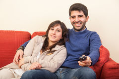 Young Couple on the Sofa Royalty Free Stock Photos