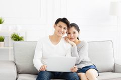 Young Couple on sofa with laptop Royalty Free Stock Photo