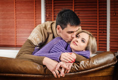 Young couple in the sofa Royalty Free Stock Images