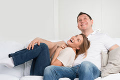 Young couple on the sofa in love Stock Images