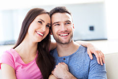 Young couple on sofa Royalty Free Stock Photos