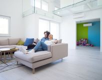 Young couple on the sofa watching television Stock Photos
