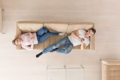 Young couple on the sofa watching television top view Stock Photography