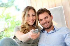 Young couple in sofa watching tv Royalty Free Stock Image
